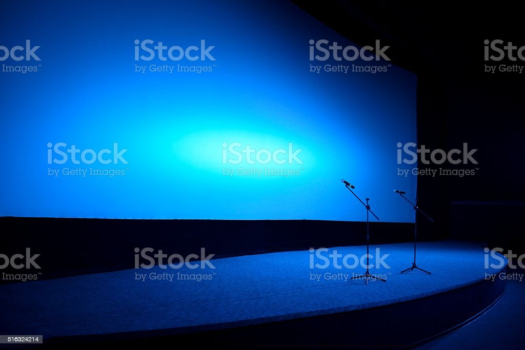 Empty stage in blue light stock photo