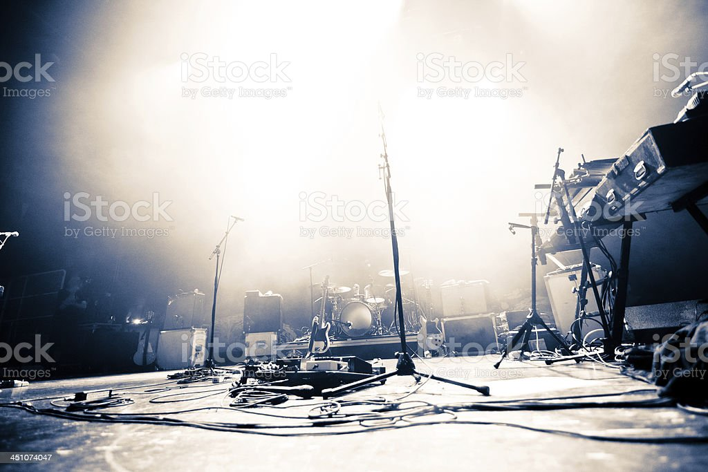 Empty stage littered with musical accessories stock photo