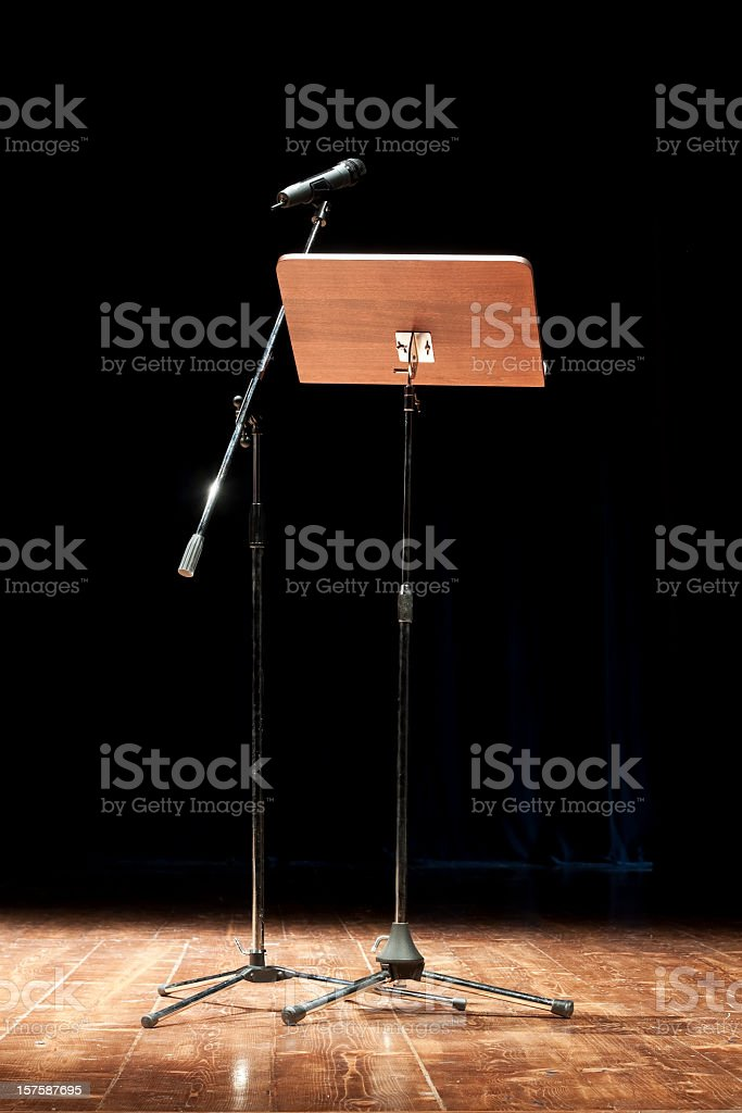 Empty stage with lectern and microphone stand royalty-free stock photo