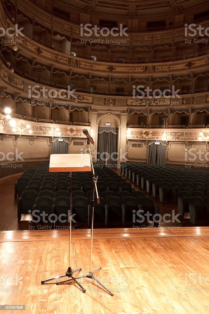 Empty stage with lectern and microphone stand stock photo