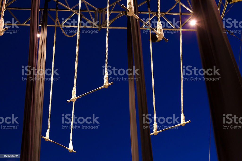 Empty standing trapezes stock photo