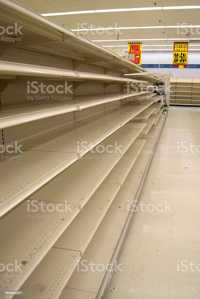 Empty store shelves in a grocery store royalty-free stock photo