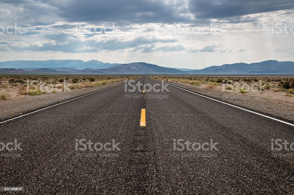 Empty straight highway in the West stock photo