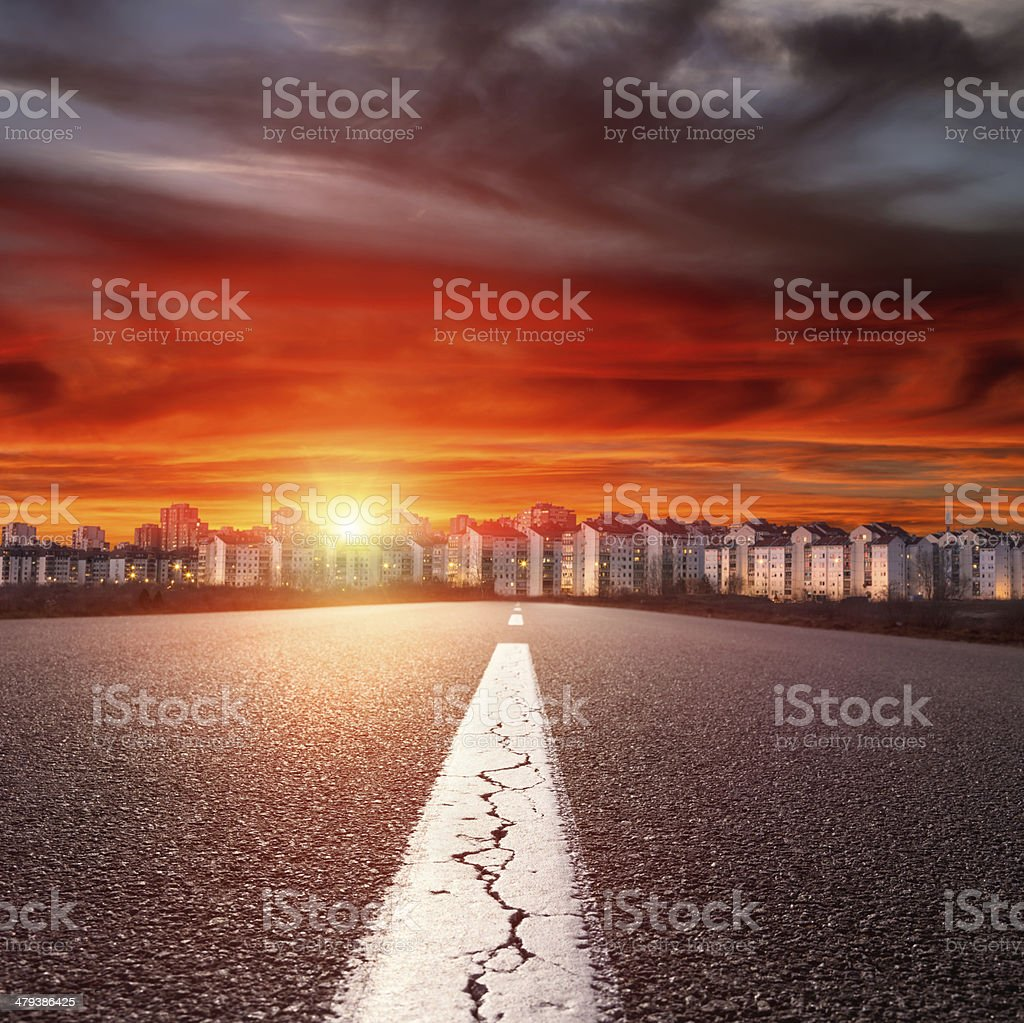 Empty straight road. Entry into the downtown at sunset stock photo