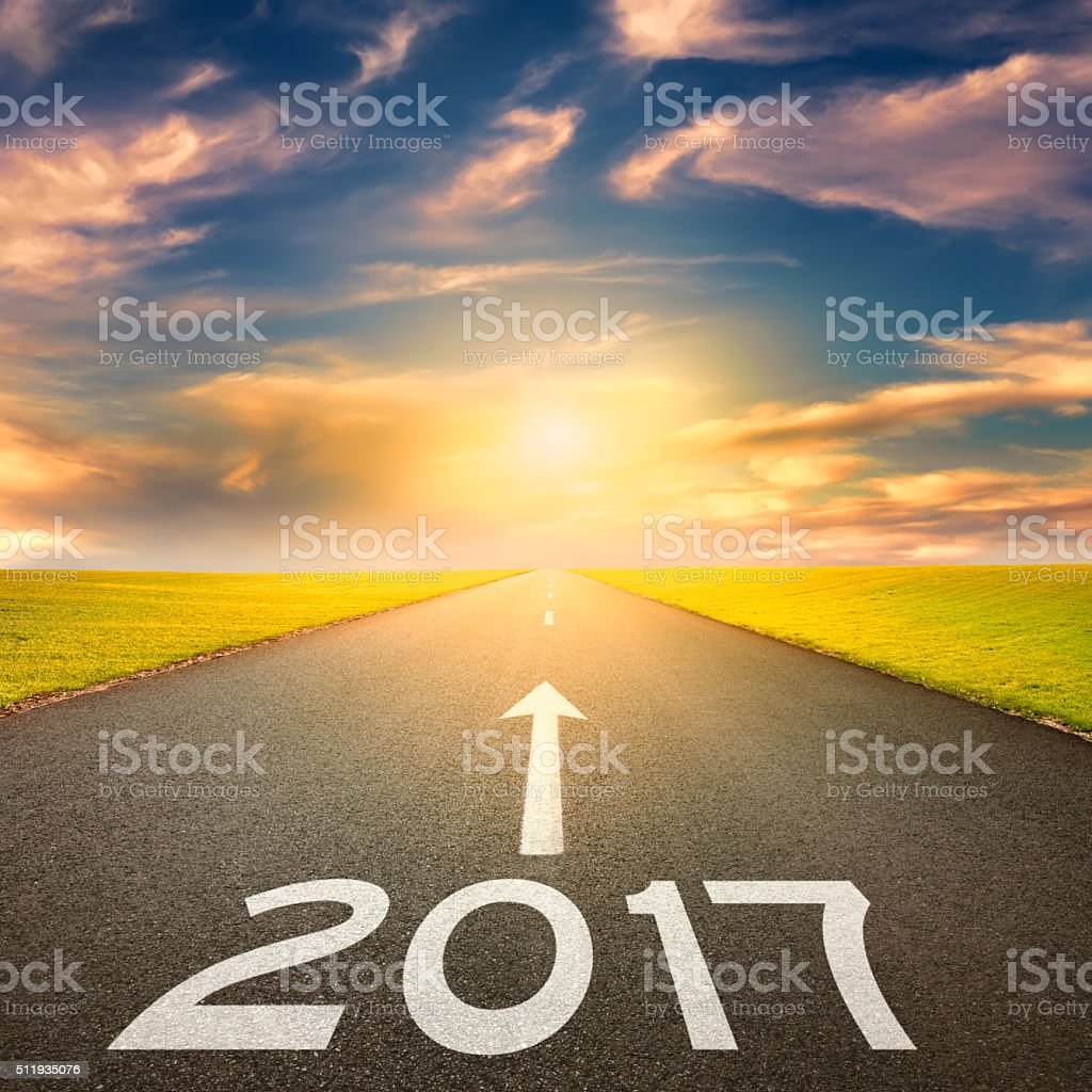 Empty straight road to upcoming 2017 at sunset stock photo