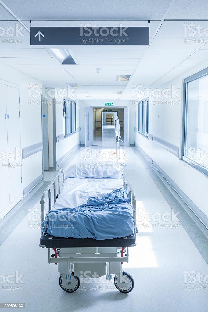 Empty Stretcher Bed Gurney in Hospital Corridor stock photo