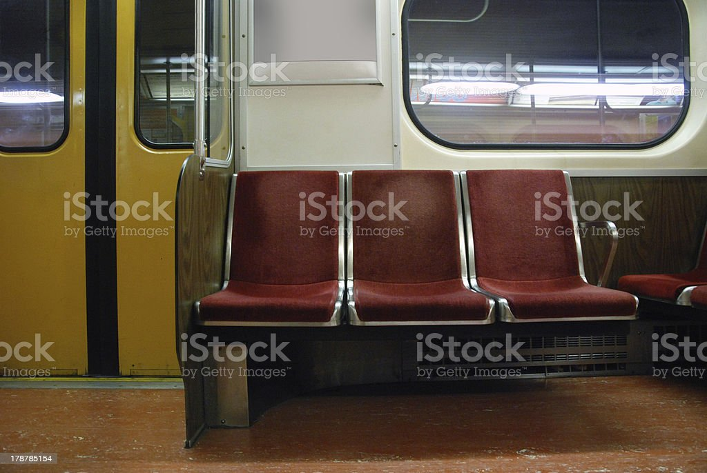 Empty subway seats stock photo