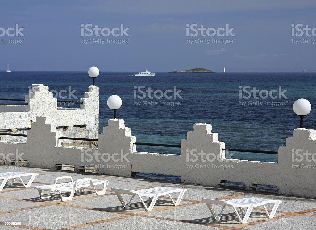 empty sun beds on terrace stock photo