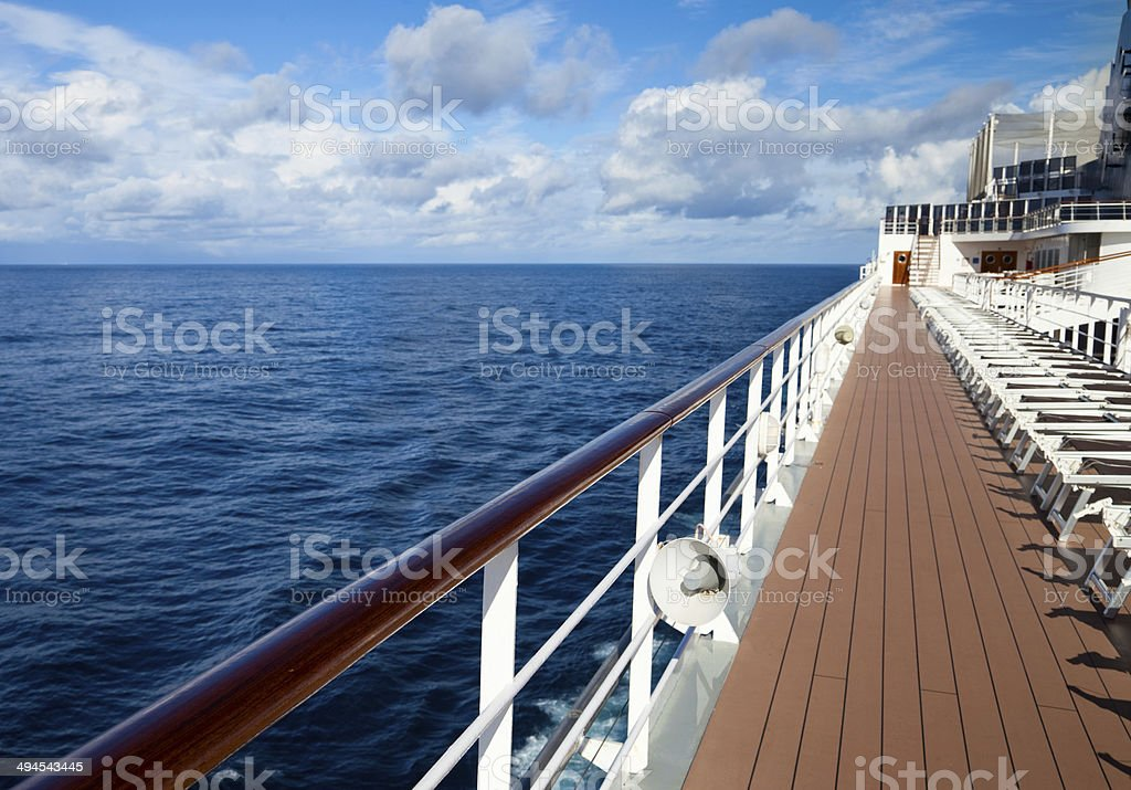 Empty sun loungers on deck of ship stock photo