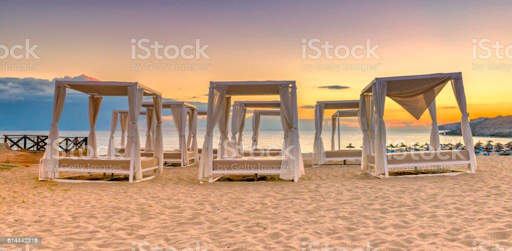Empty sunbeds at beautiful beach stock photo