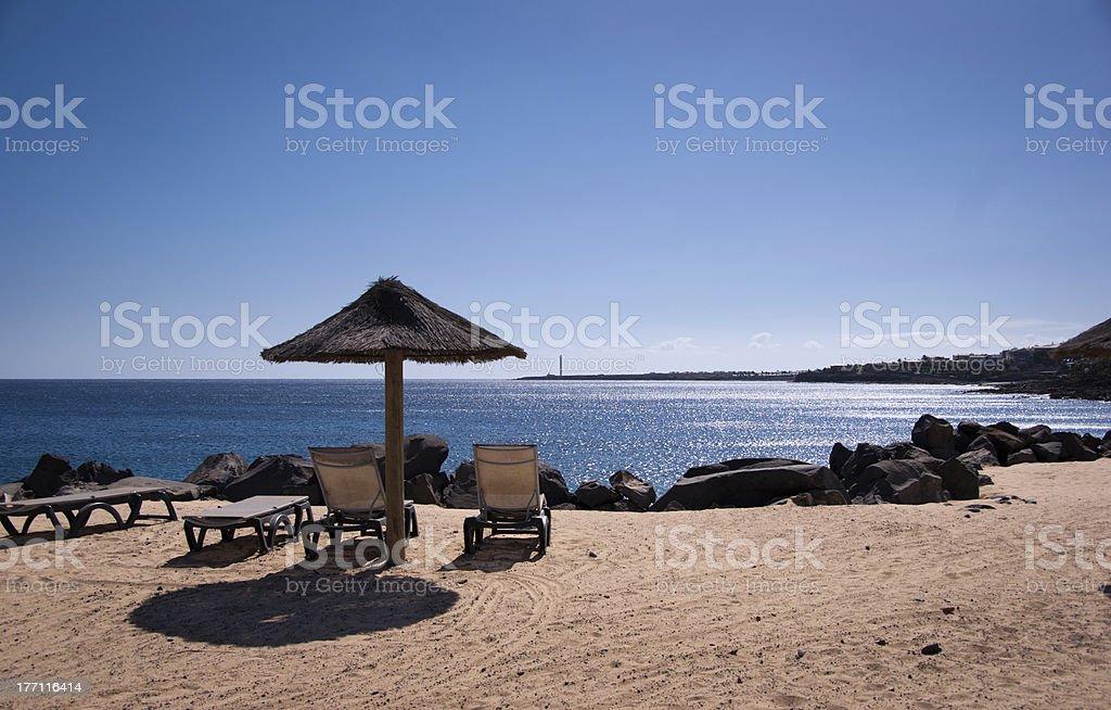 empty sunbeds in playa blanca stock photo