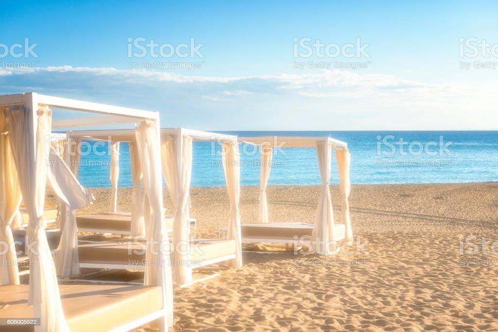 Empty sundbeds at the beach stock photo
