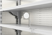 Empty supermarket shelves isolated on white background. Include clipping path.