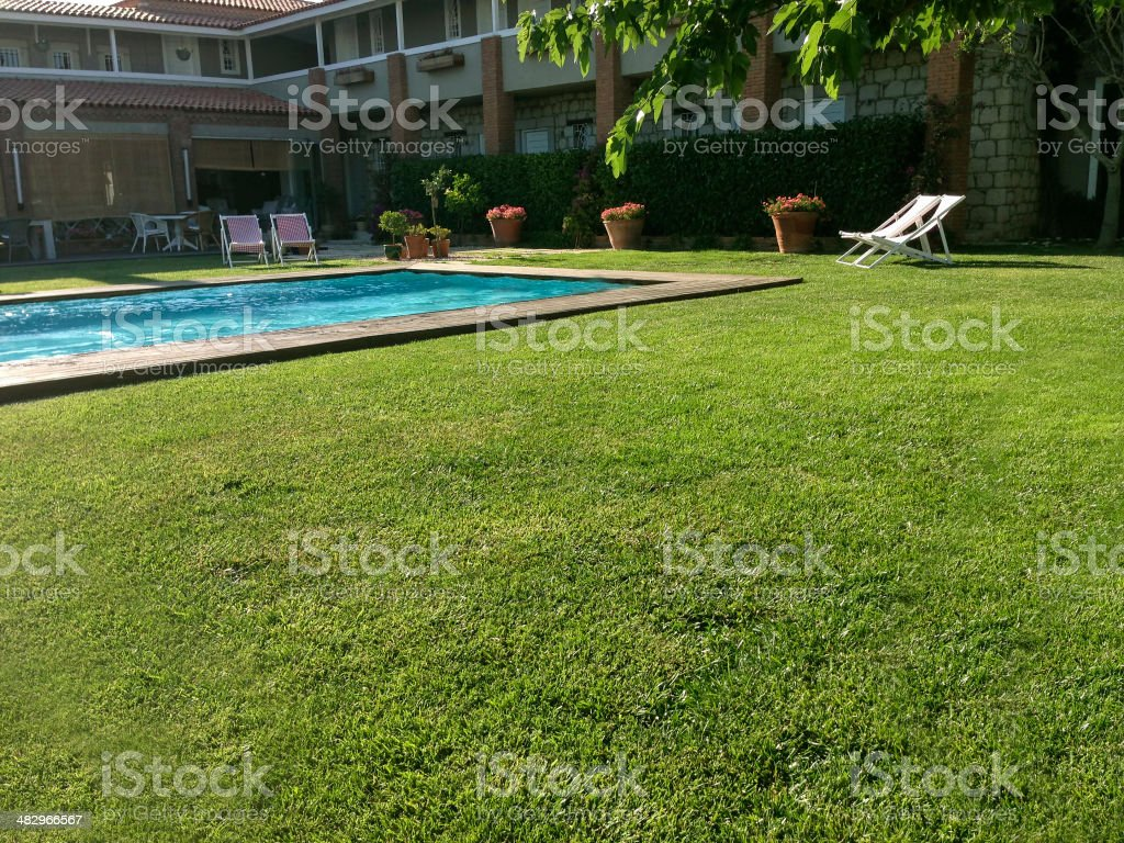 Empty Swimming Pool and Garden , Country Club Backyard