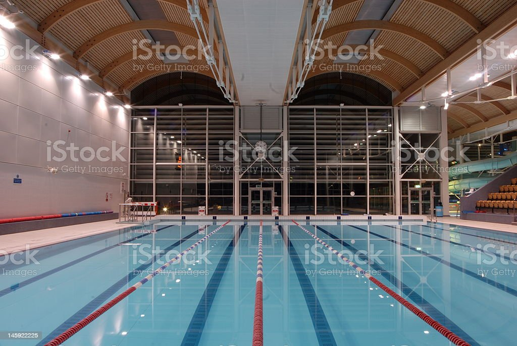 empty swimming pool at night time stock photo