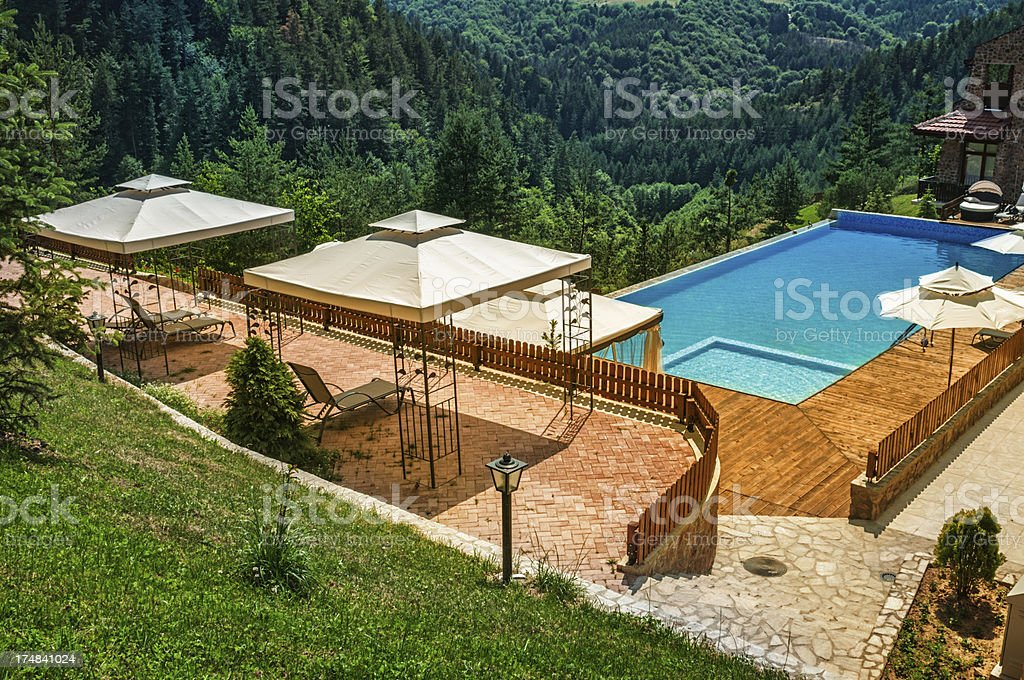 Empty Swimming Pool Deep in the Mountains royalty-free stock photo