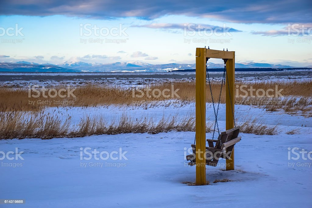Empty swing chair in cold Canadian winter royalty-free stock photo