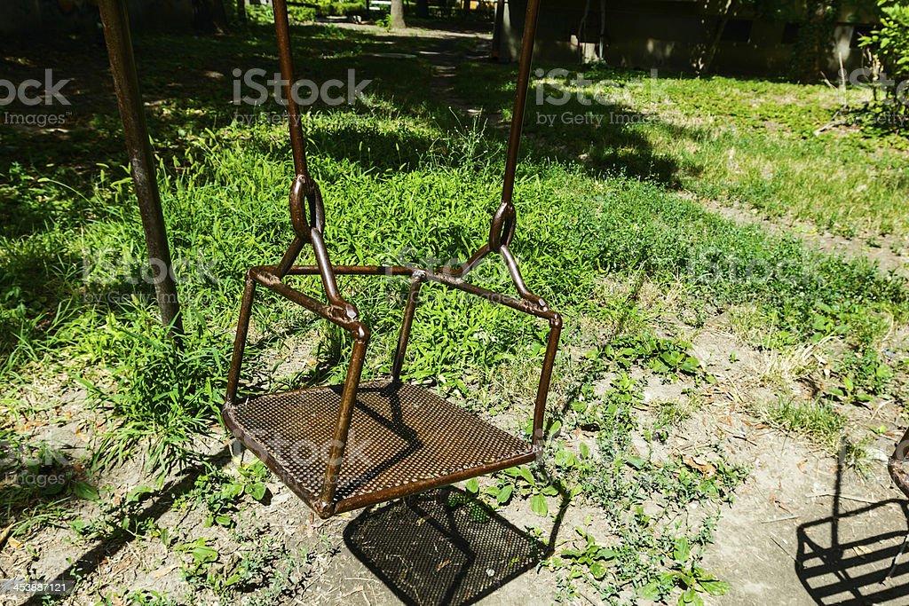 Empty swings on playground royalty-free stock photo