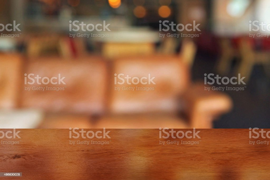Empty table edge in a lounge bar, defocused background stock photo
