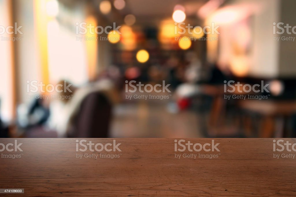 Empty table in a modern cafeteria with daylight, defocused background stock photo