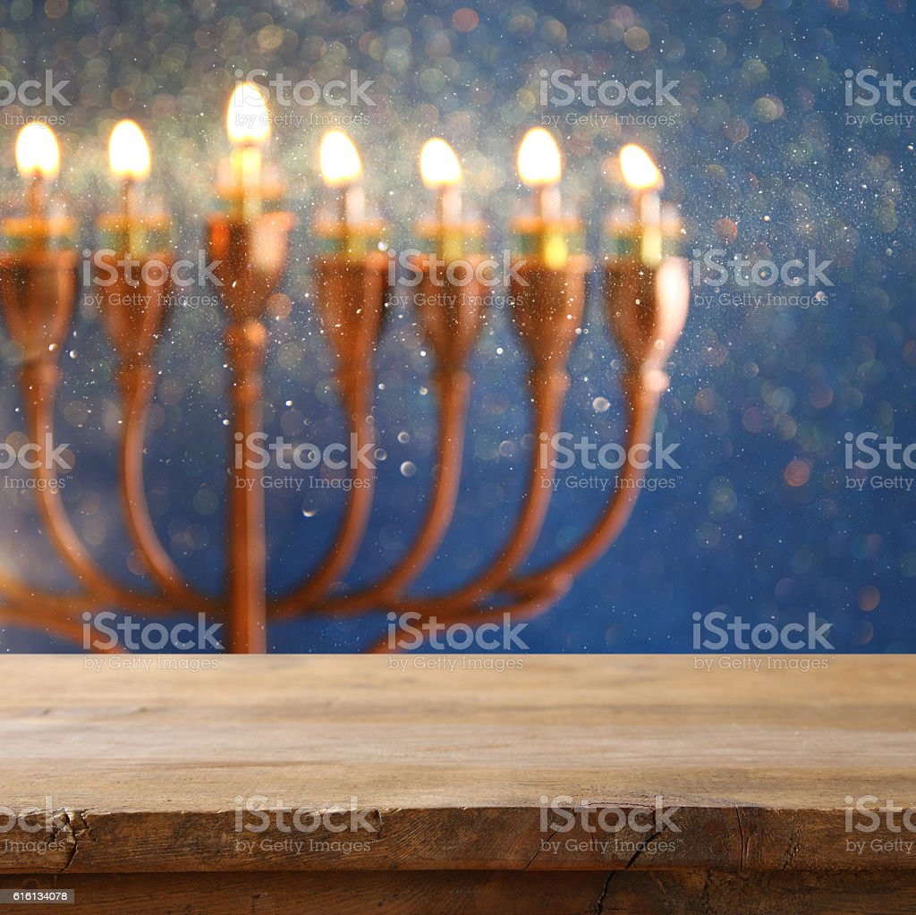 Empty table in front of jewish holiday Hanukkah background stock photo