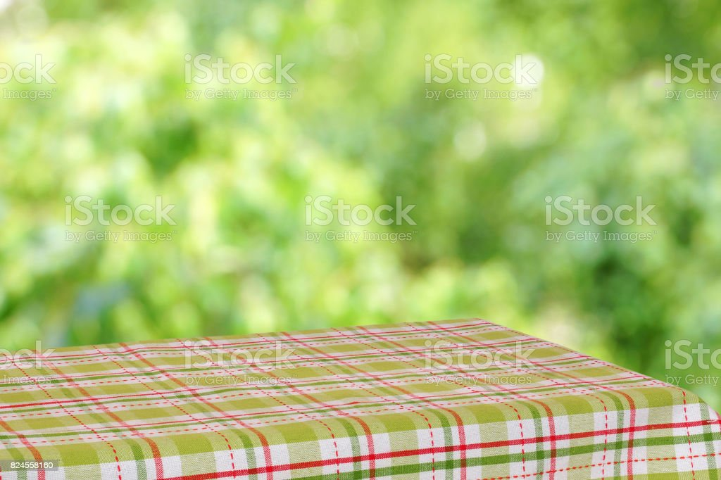 Empty table in the summer garden. stock photo