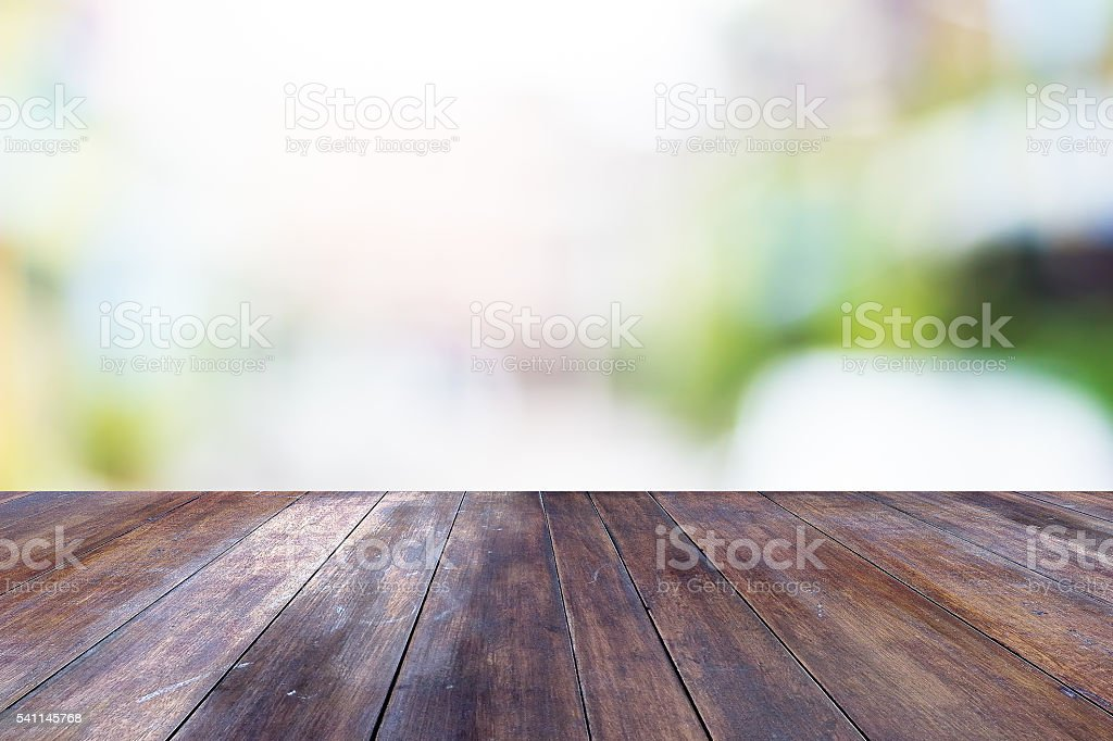 Empty table on blurred green background. stock photo