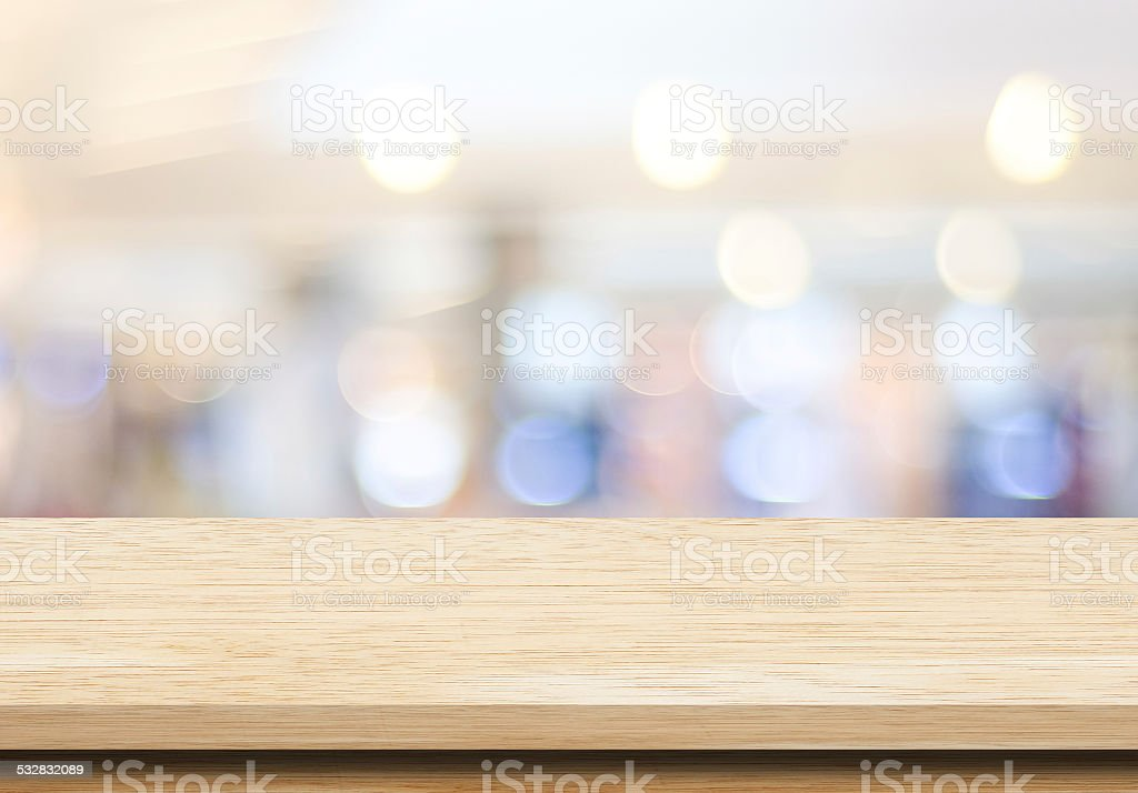 Empty table over blur festive bokeh background stock photo