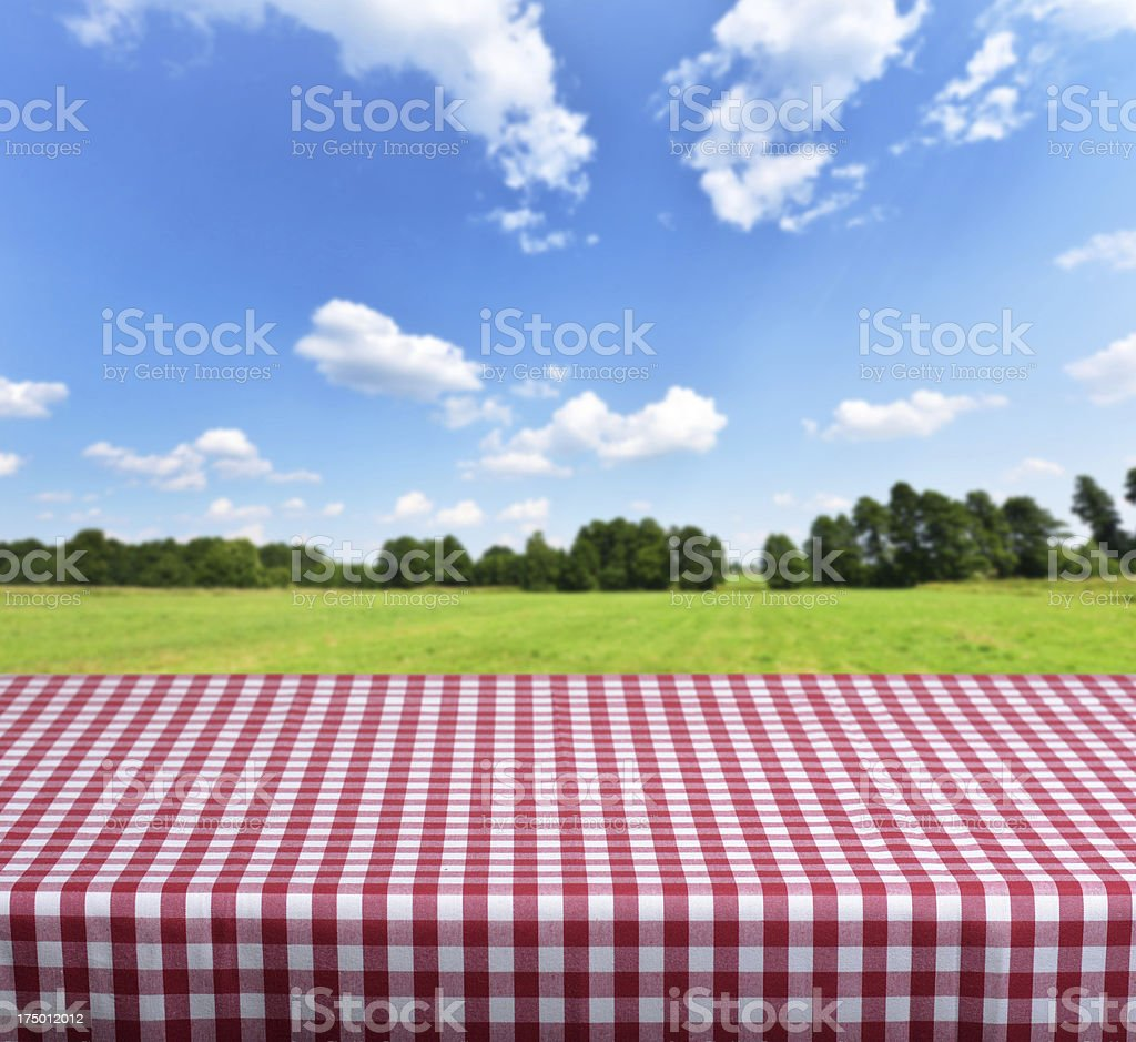 Empty table with checkered tablecloth royalty-free stock photo