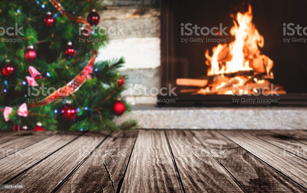 empty table with the fire log for christmas stock photo