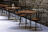 empty tables and chairs in the cafe