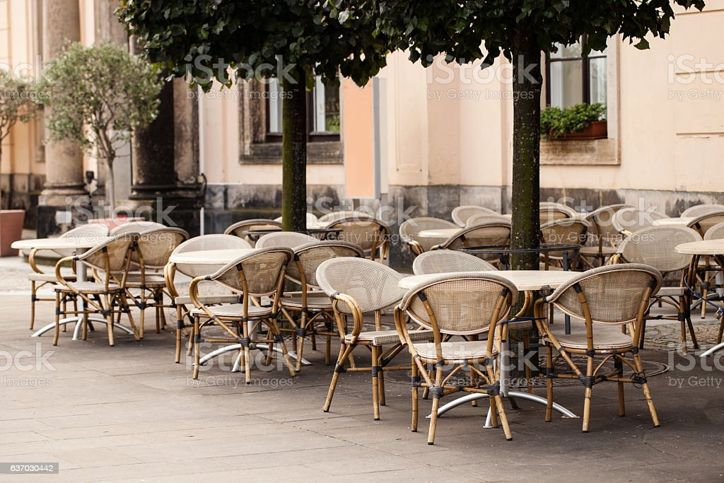 Empty tables in between dining hours along a Paris stock photo