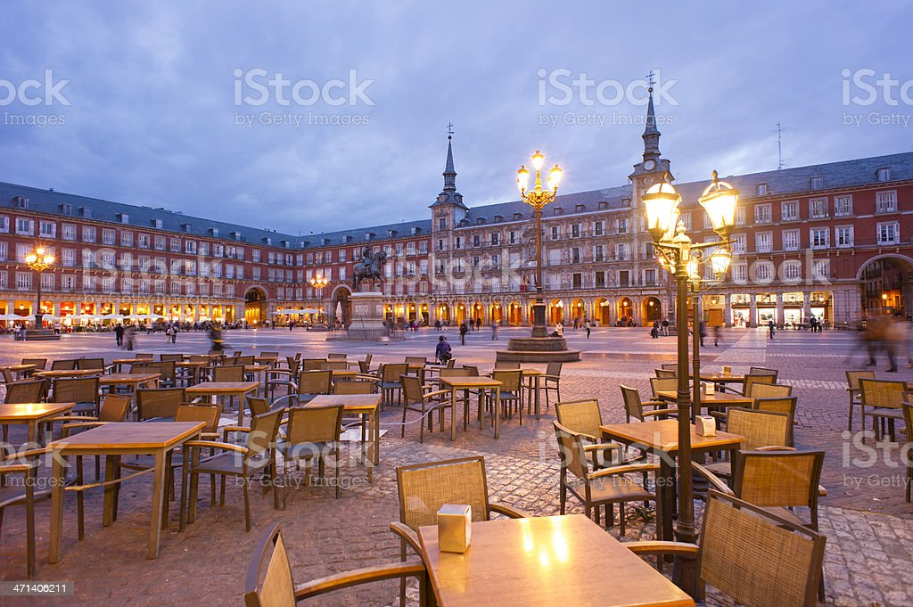 Empty tables in Plaza Mayor, Madrid at dusk stock photo