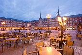 Empty tables in Plaza Mayor, Madrid at dusk