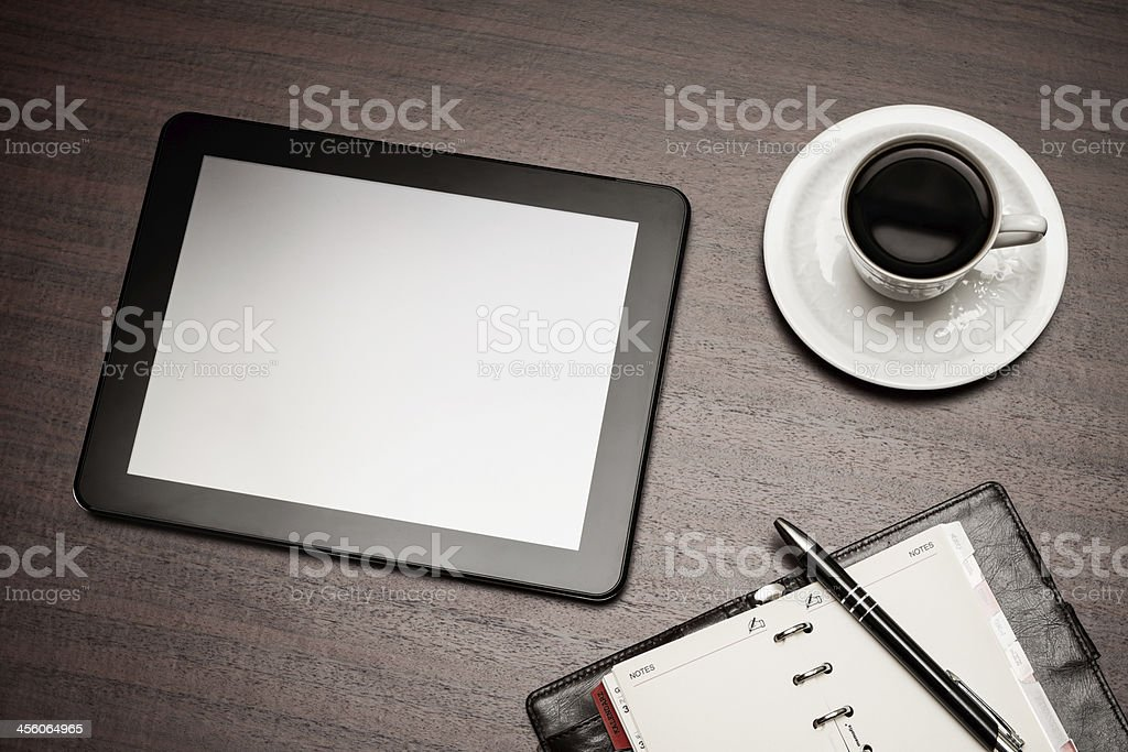 empty tablet and a cup of coffee in office royalty-free stock photo