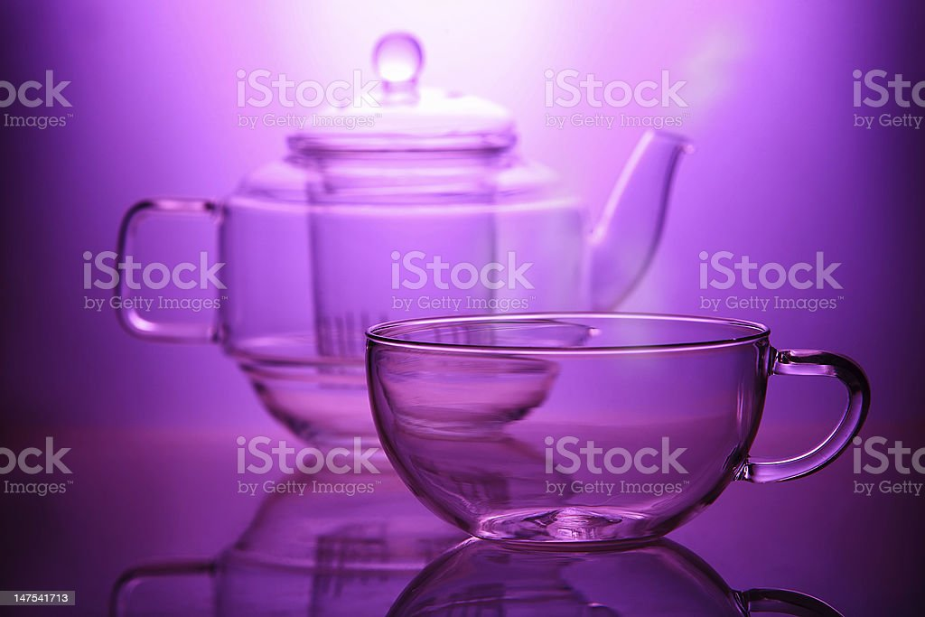 Empty teapot with steam and cup royalty-free stock photo