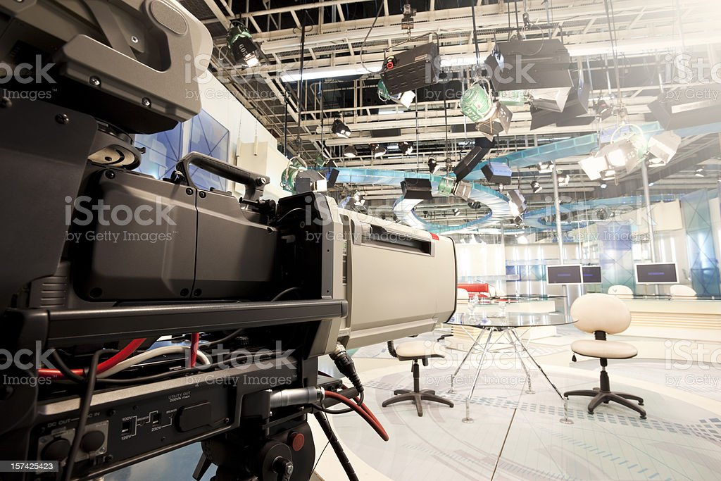 Empty television studio with camera royalty-free stock photo