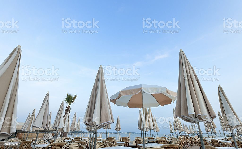 empty terrace of Carlton Hotel Cannes with parasols at sunset stock photo