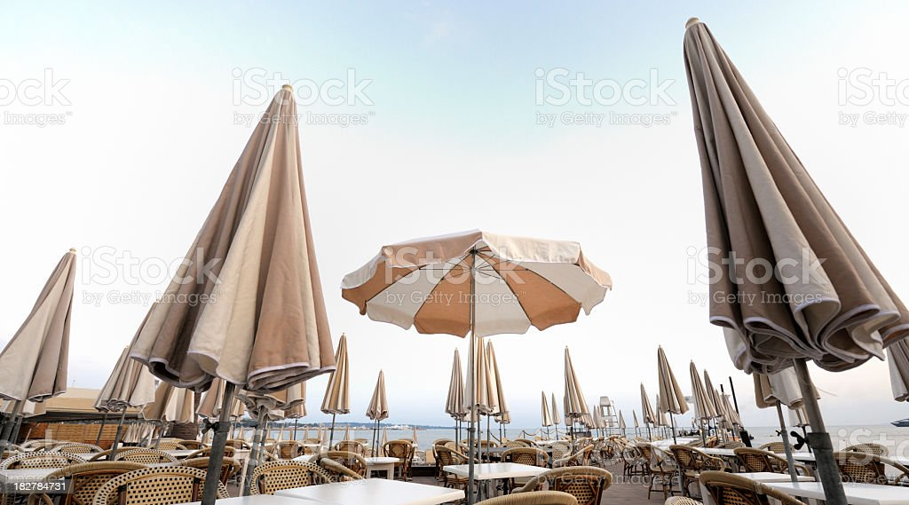 empty terrace of Carlton Hotel Cannes with sunshades at sunset stock photo