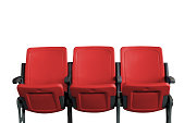Empty theater auditorium or cinema with three red seats