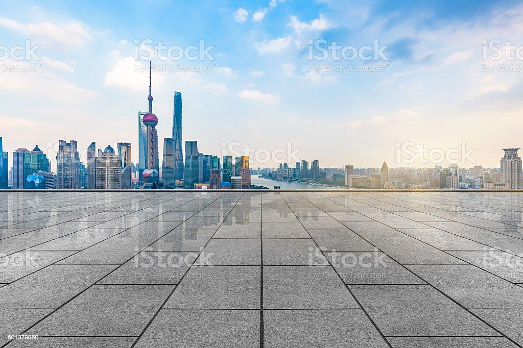 empty tiled floor with city skyline background stock photo