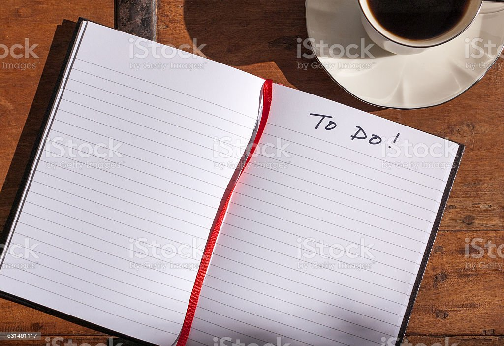 Empty to do list and coffee cup on table stock photo