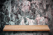 Empty top of natural stone shelves and stone wall