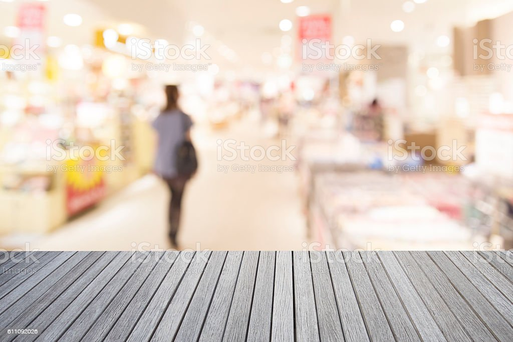 Empty top of wooden table and supermarket blur background stock photo