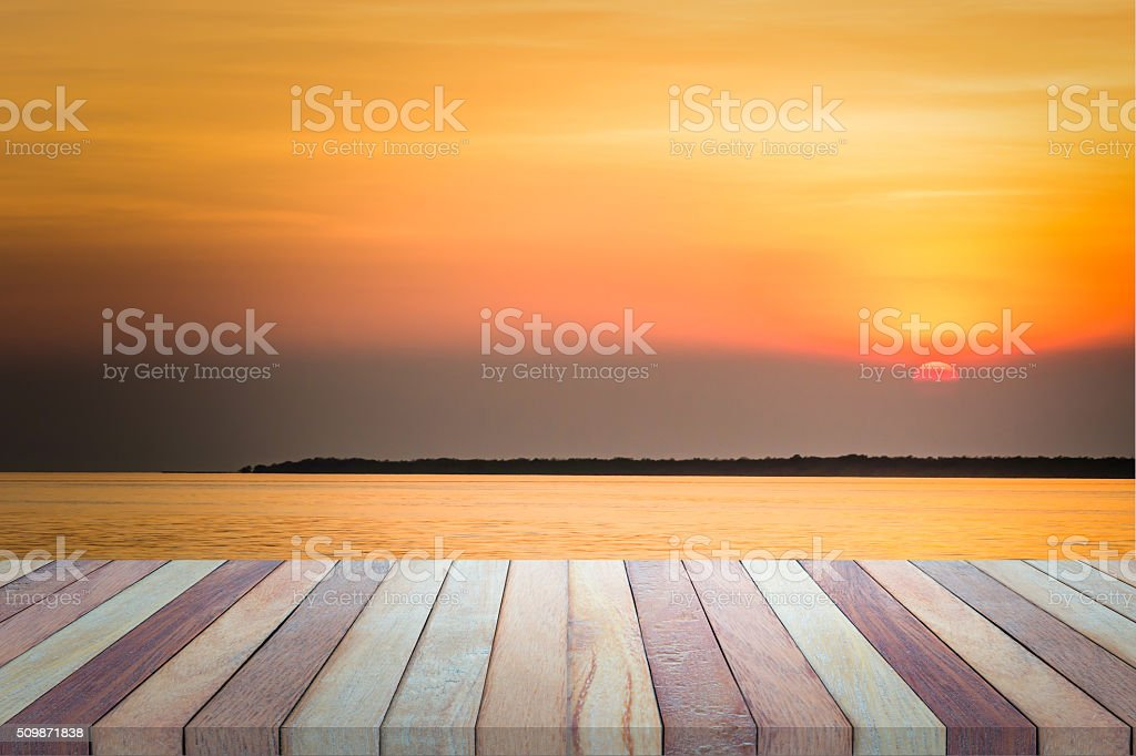 Empty top view of wooden table and view of sunset. stock photo