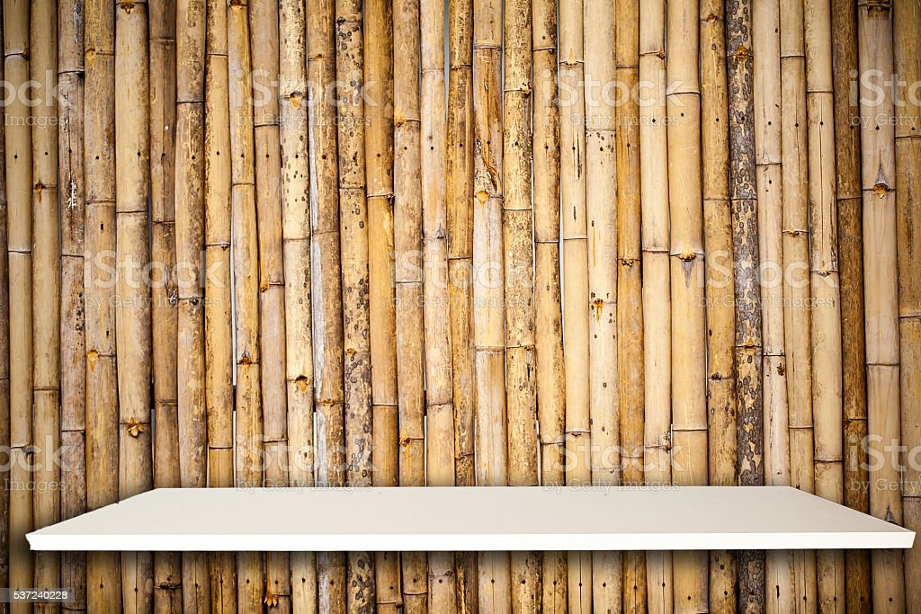 Empty top white shelves and bamboo background stock photo