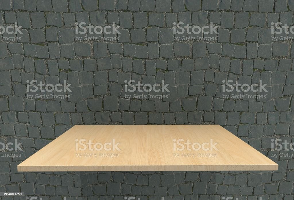 Empty top wood laminate floor shelves and cobblestone wall background. For product display stock photo