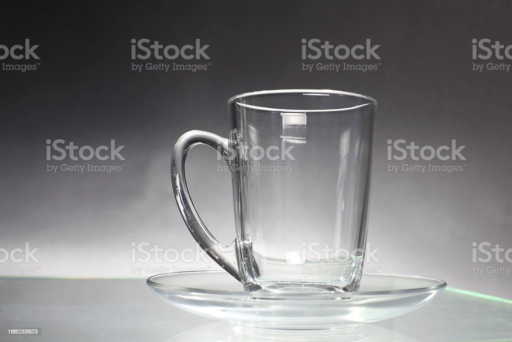 Empty transparent glass cup and saucer royalty-free stock photo