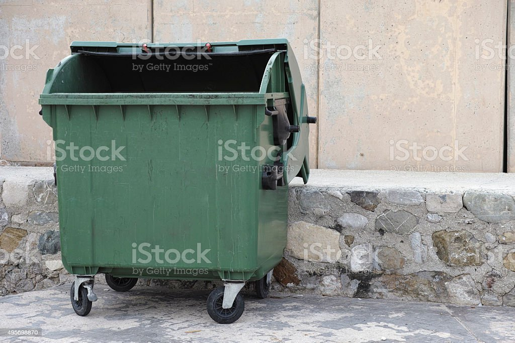 Empty trash dumpster stock photo