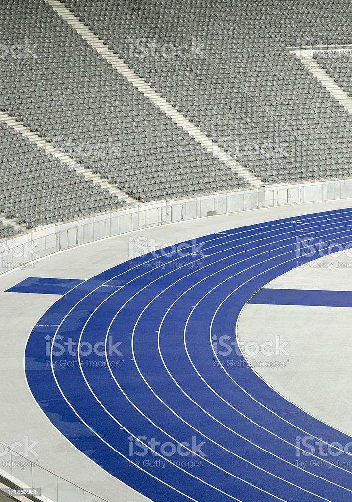Empty tribune and athletics track stock photo